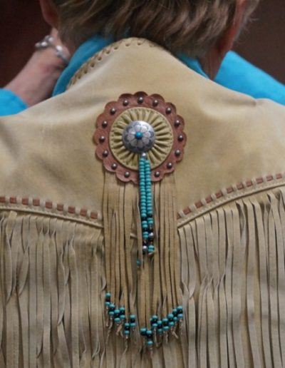 audience_leather_vest_turquoise